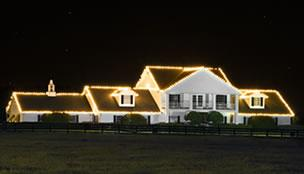 Ranch with lights along the roof